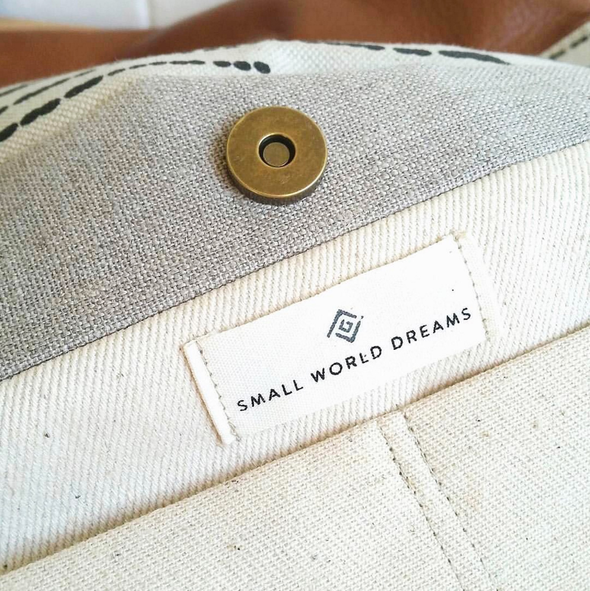 Stitched label with Small World Dreams logo