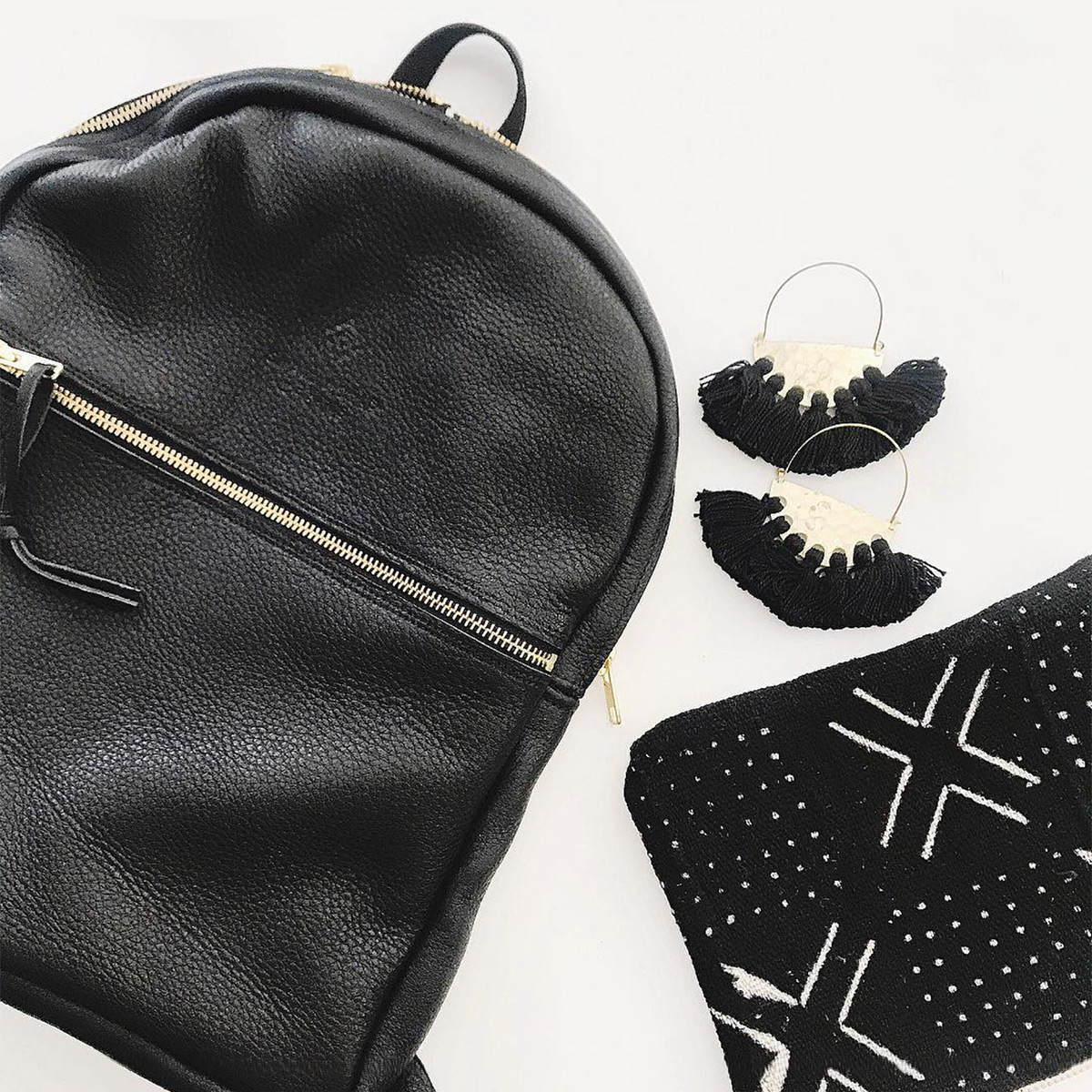 Small World Dream backpack and clutch bag